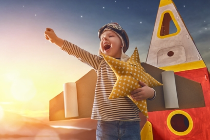A child playing an aspiring astronaut