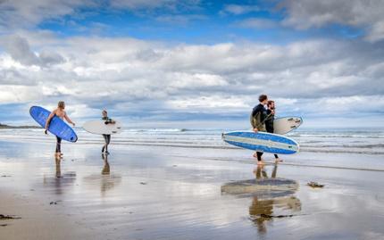 Surfers at Bamburgh
